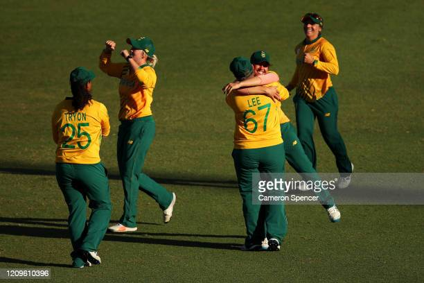 Sune Luus of South Africa and Lizelle Lee of South Africa celebrate winning the ICC Women's T20 Cricket World Cup match between South Africa and...