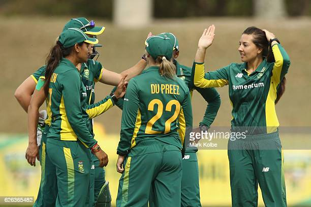 Sune Luus of South Africa celebrates with her team after taking the wicket of Nicole Bolton of Australia during the women's one day international...