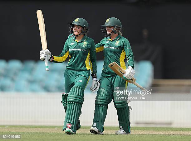 Sune Luus of South Africa is congratulated by Mignon du Preez of South Africa after reaching her fifty during the women's one day international match...