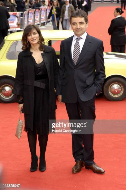 """Sunetra Sastry and Rowan Atkinson during """"Mr. Bean's Holiday"""" London Charity Premiere - Outside Arrivals at Odeon Leicester Square in London, Great..."""