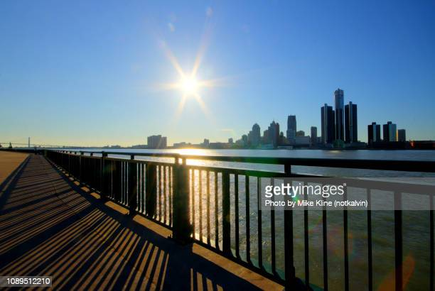 sunflares in detroit - detroit skyline stock pictures, royalty-free photos & images