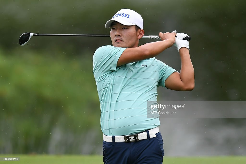Sung Hoon Kang of South Korea plays a shot on the fairway during the second round of the 2017 CIMB Classic golf tournament in Kuala Lumpur on October 13, 2017. /
