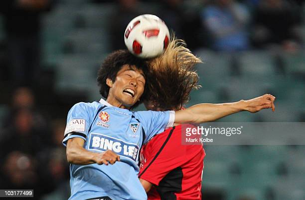 Sung Hwan Byun of Sydney FC and Michel Salgado of Rovers compete for the ball in the air during the pre-season friendly match between Sydney FC and...