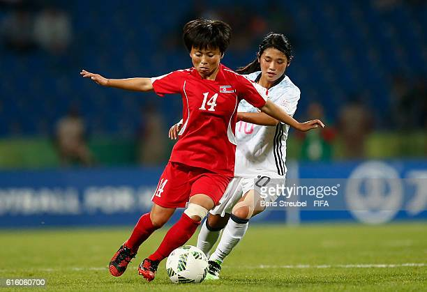 Sung Hyang Sim of Korea DPR is challenged by Fuka Nagano of Japan during the FIFA U17 Women's World Cup Finale match between Korea DPR and Japan at...