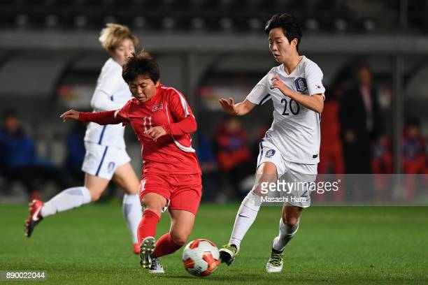 Sung Hyang Sim of North Korea and Kim Hyeri of South Korea compete for the ball during the EAFF E1 Women's Football Championship between North Korea...