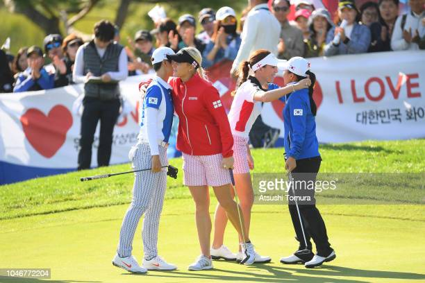 Sung Hyun Park and In-Kyung Kim of South Korea congratulated by Charley Hull and Georgia Hall of England after their victory on the 16th green in the...