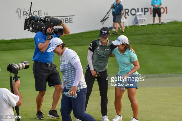 Sung Hyun Park is hugged by Nasa Hataoka after Hataoka and Amy Yang doused her with water following round 4 play of the Indy Women in Tech...