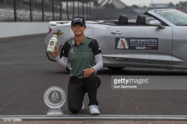 Sung Hyun Park is presented a bottle of milk and the trophy for winning the Indy Women in Tech Championship on August 19 2018 at Brickyard Crossing...