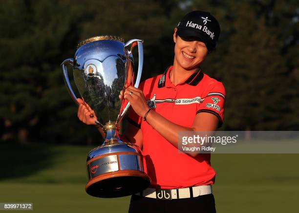 Sung Hyun Park of Korea celebrates with the trophy after winning the Canadian Pacific Women's Open following the final round at the Ottawa Hunt Golf...