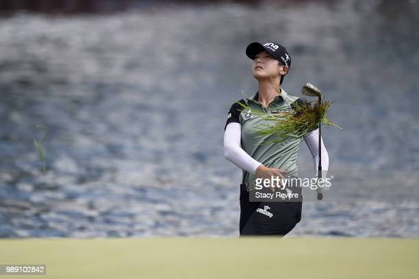 Sung Hyun Park of Korea chips to the 16th green during the final round of the KPMG Women's PGA Championship at Kemper Lakes Golf Club on July 1 2018...