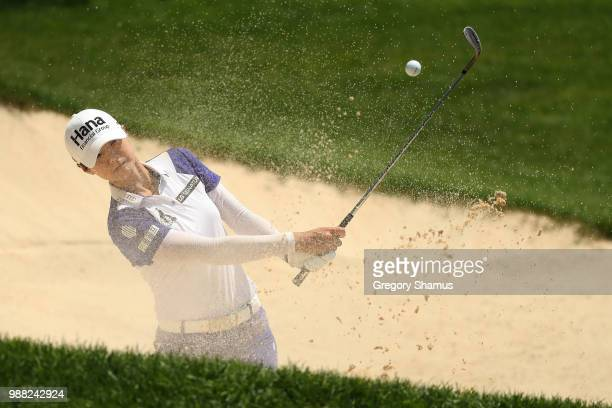 Sung Hyun Park of Korea hits from a green side sand trap to the third green during the final round of the 2018 KPMG PGA Championship at Kemper Lakes...