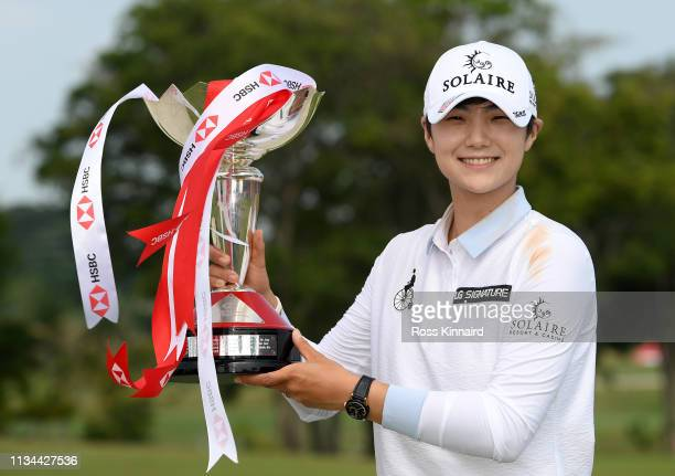 Sung Hyun Park of Korea poses with the winners trophy after the final round of the HSBC Women's World Championship at Sentosa Golf Club on March 03,...
