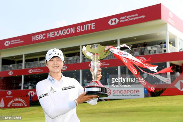 Sung Hyun Park of Korea poses with the winners trophy after the final round of the HSBC Women's World Championship at Sentosa Golf Club on March 03...