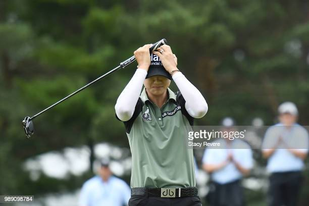 Sung Hyun Park of Korea reacts on the second playoff hole after winning the 2018 KPMG Women's PGA Championship at Kemper Lakes Golf Club on July 1...