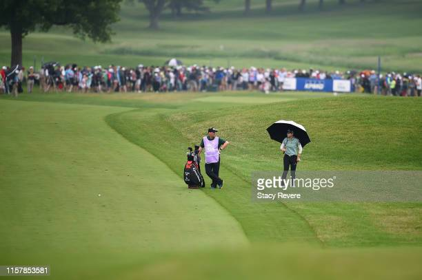 Sung Hyun Park of Korea waits to hit her second shot on the 18th hole during the final round of the KPMG PGA Championship at Hazeltine National Golf...
