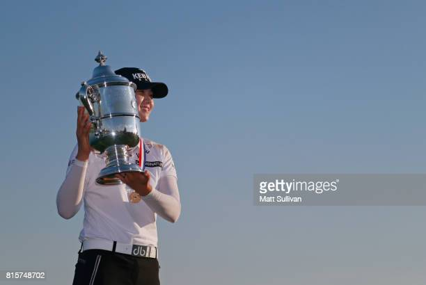 Sung Hyun Park of Sourth Korea poses with the trophy after winning the US Women's Open Championship at Trump National Golf Club on July 16 2017 in...