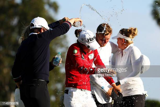 Sung Hyun Park of South Korea and Hannah Green of Australia douse Minjee Lee of Australia with water after her HUGELAIR PREMIA LA Open victory at...