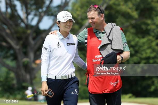 Sung Hyun Park of South Korea and her caddie celebrate after finishing on the 18th green during the final round of the HSBC Women's World...