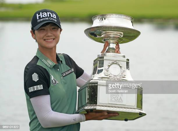 Sung Hyun Park of South Korea celebrates with the trophy after winning the KPMG Women's PGA Championship at Kemper Lakes Golf Club on July 1 2018 in...