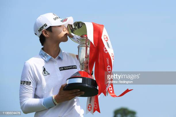 Sung Hyun Park of South Korea celebrates with the winner's trophy after the final round of the HSBC Women's World Championship at Sentosa Golf Club...