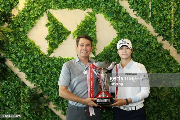 Sung Hyun Park of South Korea celebrates with Tony Cripps CEO HSBC Singapore and the winner's trophy after the final round of the HSBC Women's World...