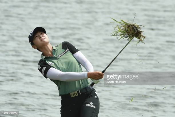 Sung Hyun Park of South Korea plays a shot from the water's edge on the 16th hole during the final round of the KPMG Women's PGA Championship at...