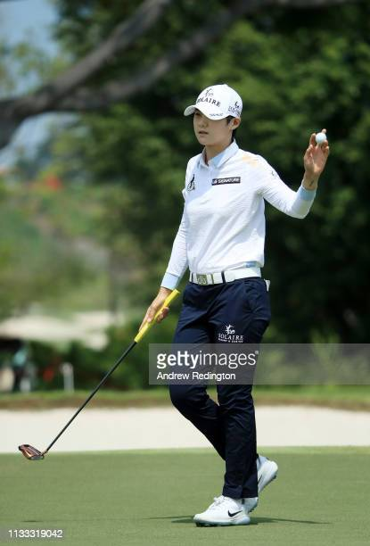 Sung Hyun Park of South Korea reacts after finishing on the 18th green during the final round of the HSBC Women's World Championship at Sentosa Golf...