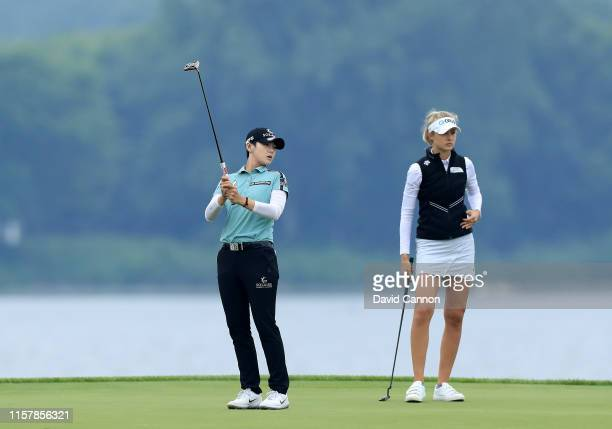 Sung Hyun Park of South Korea reacts after just missing a birdie putt on the par 4 16th hole watched by her playing partner Nelly Korda of the United...