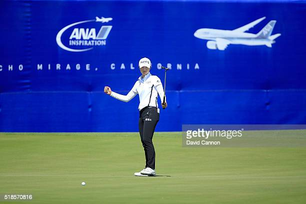 Sung Hyun Park of South Korea reacts as her birdie putt on the 18th hole heads towards the hole during the second round of the 2016 ANA Inspiration...