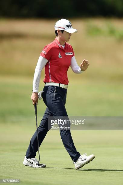 Sung Hyun Park of South Korea waves to the crowd following a birdie on the first hole during the final round of the Meijer LPGA Classic at...