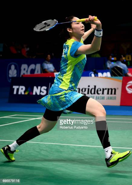 Sung Ji Hyun of Korea competes against Dinar Dyah Ayustine of Indonesia during Womens Single Round 1 match of the BCA Indonesia Open 2017 at Plenary...
