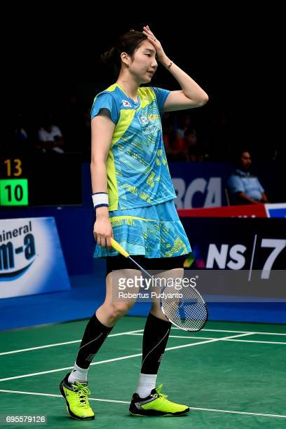 Sung Ji Hyun of Korea reacts against Dinar Dyah Ayustine of Indonesia during Womens Single Round 1 match of the BCA Indonesia Open 2017 at Plenary...