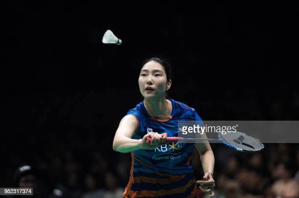Sung JiHyun of South Korea hits a return against Chen Yufei of China during their women's singles semifinals match at the 2018 Badminton Asia...