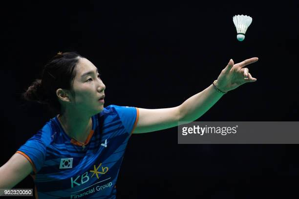 Sung JiHyun of South Korea serves to Chen Yufei of China during their women's singles semifinals match at the 2018 Badminton Asia Championships in...