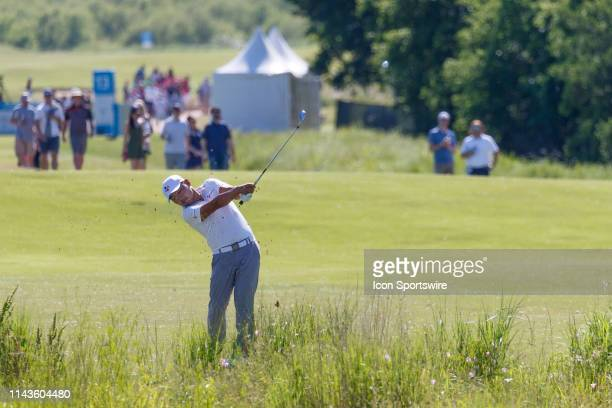 Sung Kang hits his approach shot to during the final round of the ATT Byron Nelson on May 12 2019 at Trinity Forest Golf Club in Dallas TX