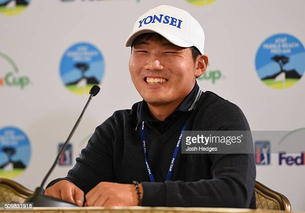 Sung Kang of Korea interacts with media during a press conference following his second round of the ATT Pebble Beach National ProAm at the Monterey...