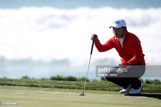 Sung Kang of Korea lines up a putt on the 10th green during round three of the ATT Pebble Beach National ProAm at the Pebble Beach Golf Links on...