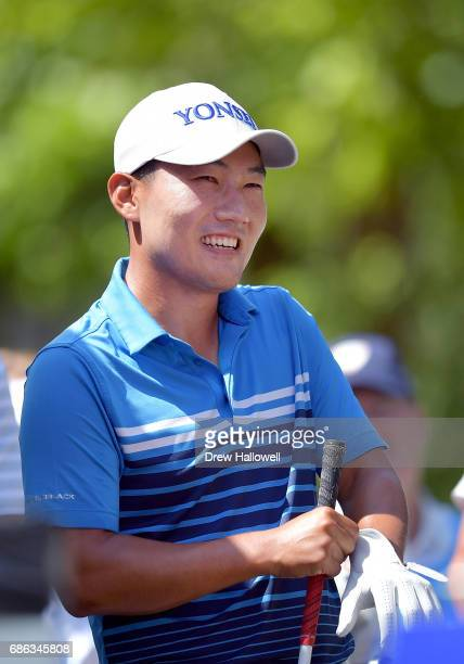 Sung Kang of Korea perpares to play his shot from the first tee during the Final Round of the ATT Byron Nelson at the TPC Four Seasons Resort Las...