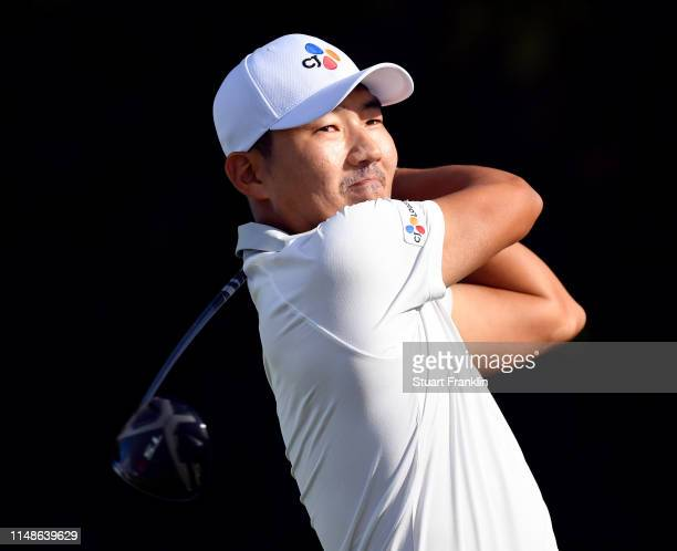 Sung Kang of Korea plays a shot during the continuation of the weather delayed third round at the ATT Byron Nelson at Trinity Forest Golf Club on May...