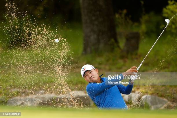 Sung Kang of Korea plays a shot from a bunker on the fourth hole during the second round of the 2019 Valero Texas Open at TPC San Antonio Oaks Course...