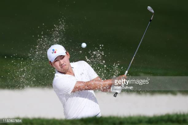 Sung Kang of Korea plays a shot from a bunker on the third hole during the first round of the Honda Classic at PGA National Resort and Spa on...
