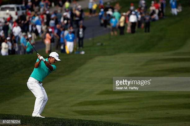 Sung Kang of Korea plays a shot from the fairway on the 15th hole during the final round of the ATT Pebble Beach National ProAm at the Pebble Beach...