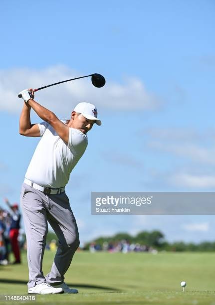 Sung Kang of Korea plays a shot on the 18th hole during the continuation of the weather delayed third round at the ATT Byron Nelson at Trinity Forest...