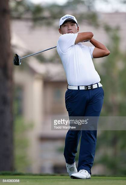 Sung Kang of Korea plays his shot from the 13th tee during the second round of the Barracuda Championship at the Montreux Golf and Country Club on...