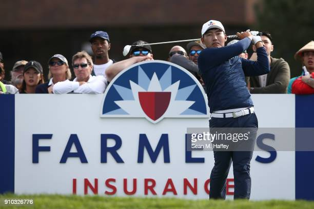 Sung Kang of Korea plays his shot from the 14th tee during the first round of the Farmers Insurance Open at Torrey Pines South on January 25 2018 in...
