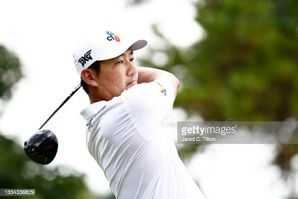 Sung Kang of Korea plays his shot from the 18th tee during the final round of the Wyndham Championship at Sedgefield Country Club on August 15, 2021...