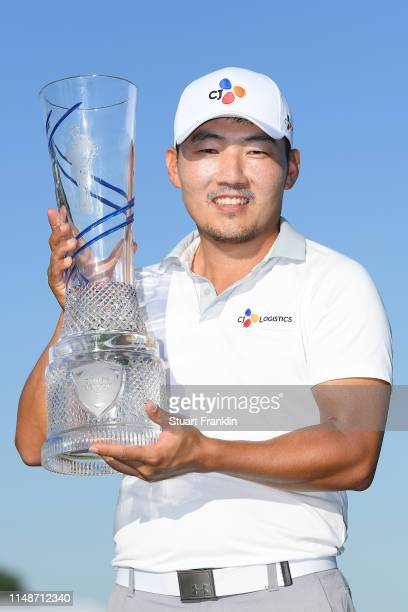 Sung Kang of Korea poses for a photo with the trophy after winning the ATT Byron Nelson at Trinity Forest Golf Club on May 12 2019 in Dallas Texas
