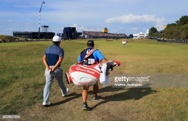 Sung Kang of Korea walks down the 18th hole with his caddie during the third round of the 146th Open Championship at Royal Birkdale on July 22 2017...
