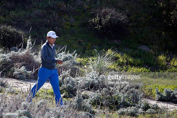 Sung Kang of Korea walks to the third tee box during the first round of the ATT Pebble Beach National ProAm at the Spyglass Hill Golf Course on on...
