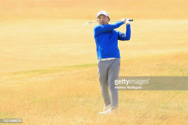 Sung Kang of South Korea hits his second shot on the 15th hole during the first round of the 147th Open Championship at Carnoustie Golf Club on July...